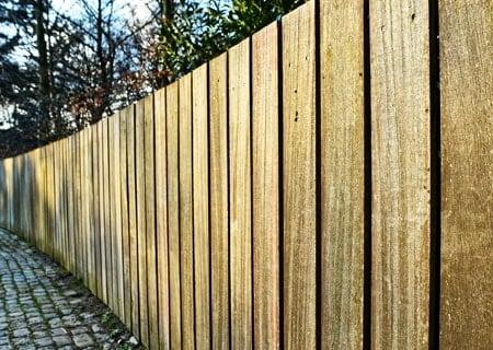 Raw wood pool fence