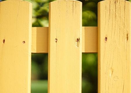 Painted wood pool fence