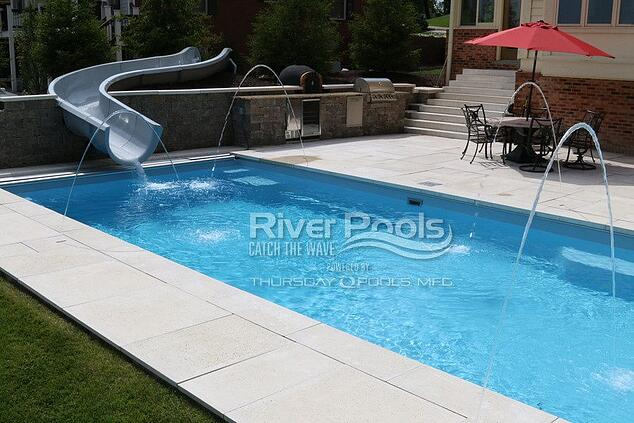 Pool slide with water features