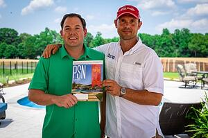 Jason (co-owner) and Jerry (CEO) holding the PSN magazine featuring River Pools as a Top 50 Pool Builder for 2018