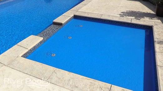 Separate tanning ledge next to main pool