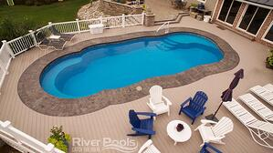 C40 fiberglass pool with deck chairs