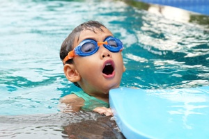 child wearing goggles in a pool