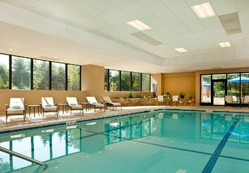 Indoor swimming pools 101 cost construction advantages and other questions explained for Disadvantage of indoor swimming pool