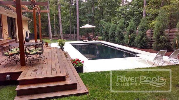 dark bottom swimming pool with wood deck