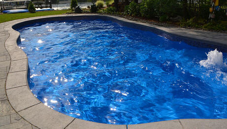 Inground fiberglass swimming pool with bubbler