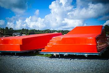 red-orange fiberglass pool molds